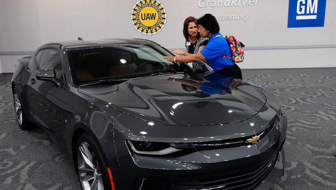 People at the news conference  get a chance to see the 2016 Chevrolet Camaro.