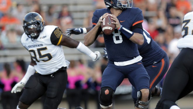 UTEP quarterback Zack Greenlee looks for a receiver down field against Southern Miss Saturday at the Sun Bowl.