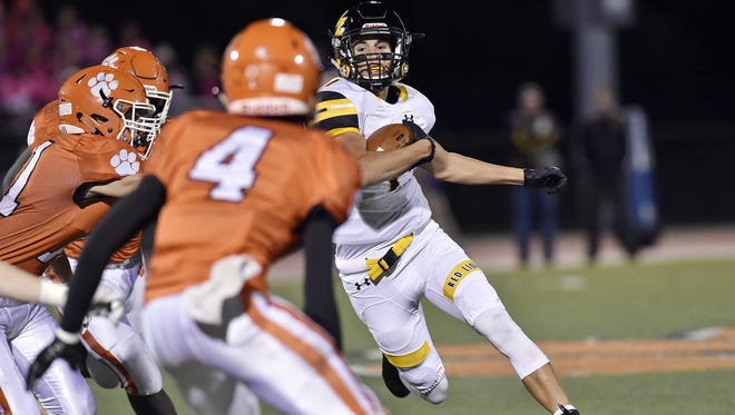 Red Lion's Zach Throne carries the ball against Central York last season. Throne will shift to quarterback this season.
