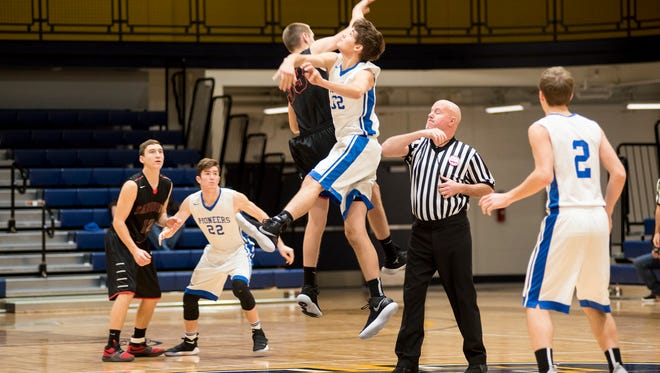 Sandusky's Ryan Campbell (33) and Cros-Lex's Chance Newberry leap high for a jump ball at last year's SC4 Holiday Basketball Showcase. This year's event begins Thursday at SC4 Fieldhouse.