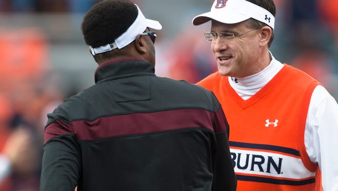 Auburn Head Coach Gus Malzahn greats Texas A&M Head Coach Kevin Sumlin before the NCAA football game between Auburn and Texas A&M on Saturday, Nov. 8, 2014, in Auburn, Ala.