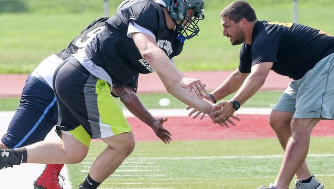 New Providence's Hudson Barth runs a drill for Union County during the first Snapple Bowl practice.