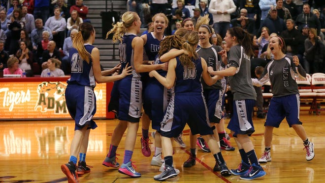 The Des Moines Christian girls basketball team celebrates their win in the 2-A regional final on Monday, Feb. 23, 2015 at Adel high school. The Panorama Panthers fell to the Des Moines Christian Lions 32-31.