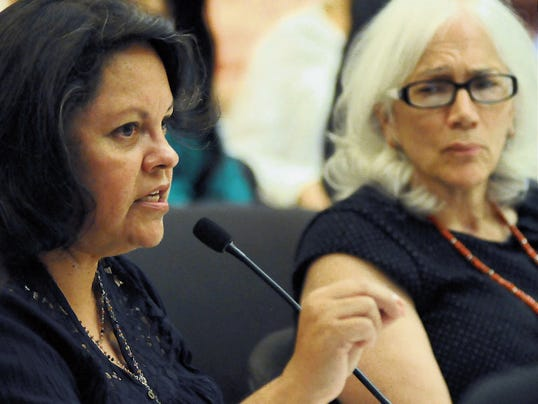 Photos by Robin Zielinski — Sun-News Suzan Martinez de Gonzales, director of La Clinica de Familia, a low-income primary care provider, left, speaks on Monday during a Mental Health Oversight Committee of Doña Ana County meeting in the Commission Chambers of the Doña Ana County Government center to discuss the transition between La Frontera — the major Medicaid-funded behavioral health provider locally — and new providers. Looking on in the background is Dr. Denise Leonardi, UnitedHealthcare Community Plan of New Mexico chief medical officer.