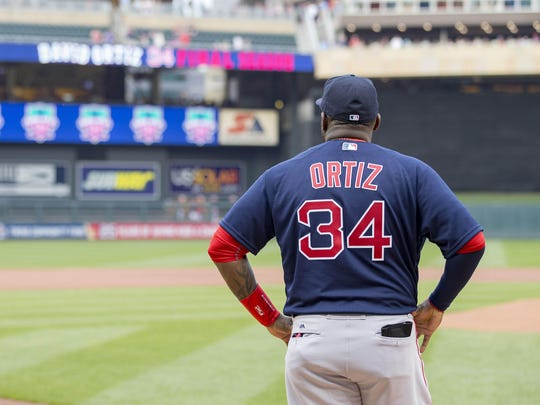 Boston Red Sox designated hitter David Ortiz (34) stands at home plate and watches a video during his final season tribute against the Minnesota Twins on Friday at Target Field in Minneapolis.