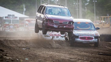 Drivers face off in multiple heats during their dirt road demolition derby race at the 2016 Delaware County Fair Wednesday night, July 20, 2016.