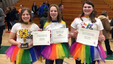 FIRST LEGO League (FLL) Team 19309 members, the Wonder Petz, hold awards the team earned at the Wisconsin State Championship in Janesville on Feb. 26. The team will travel to California for the FIRST LEGOland North American Open May 19 - 21. Pictured (from left) are Park View Middle School (PVMS) seventh graders Elise Lawton and Hannah Herbst and Section Elementary sixth grader MaryAnn Romagna.