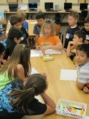 Math Snacks educator Sharon Johnson instructs students