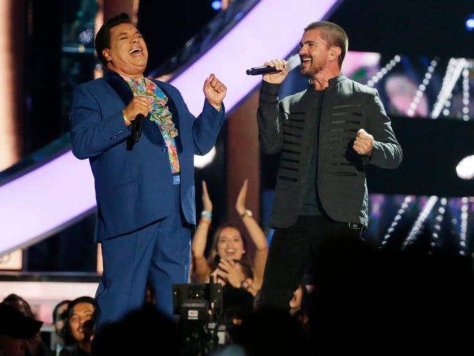 In April 2016, singers Juan Gabriel, left, and Juanes,