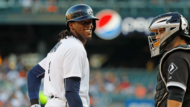 Tigers centerfielder Cameron Maybin reacts after getting hit by a pitch as White Sox catcher Alex Avila looks on during the first inning Monday at Comerica Park.