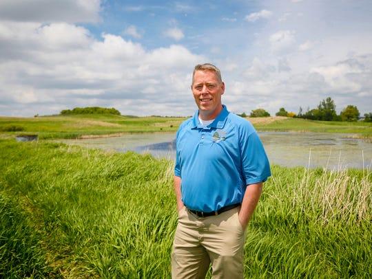 State Representative John Wills stands at a wetland