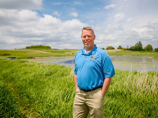 State Representative John Wills stands at a wetland near at Center Lake in Sprit Lake Monday, May 23, 2016.