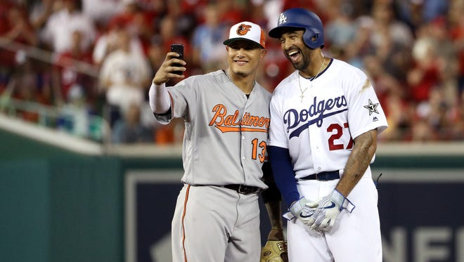 Manny Machado of the Baltimore Orioles and Matt Kemp of the Los Angeles Dodgers pose for a selfie in the second inning during the All-Star Game.