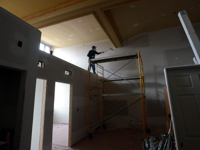 Mike Kristofferson, of LaVeve Drywall, sands down the