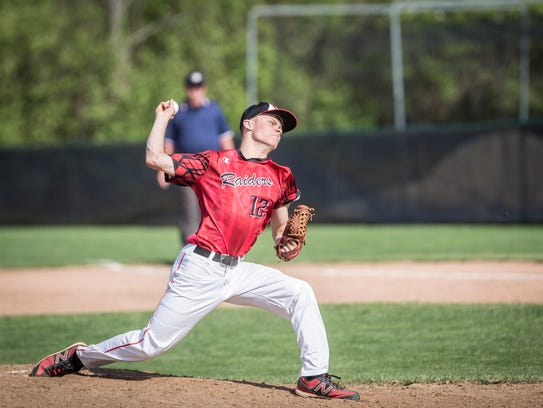 Wapahan's Chandler Wise pitches on the mound Monday