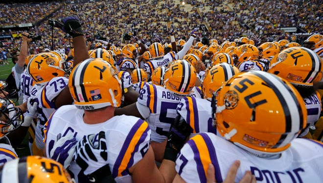 FILE - In this Oct. 17, 2015, file photo, LSU players huddle before an NCAA college football game against Florida in Baton Rouge, La. The Tigers haven't played the most imposing schedule but are coming off a 35-28 win over Florida and are the only remaining unbeaten team in the SEC. (AP Photo/Gerald Herbert, File)