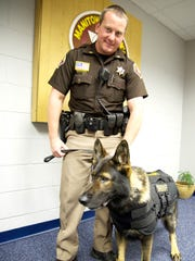 Lt. Todd Cummings and K-9 Keto show off the new vest