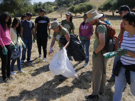 Return of the Natives director Laura Lee Lienk leads a group of volunteers during the Salinas Earth Day Celebration in 2015 at Natividad Creek Park.