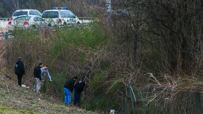January 25, 2017 - MPD and investigators from the Medical Examiners Office comb the area near an exit ramp at Airways and I-240 after possible human remains were discovered on Wednesday.