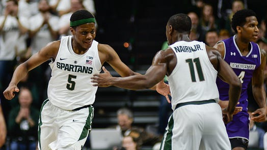 Michigan State point guards Cassius Winston (5) and Tum Tum Nairn celebrate a basket during the Spartans' 61-52 win over Northwestern on Dec. 30, 2016.