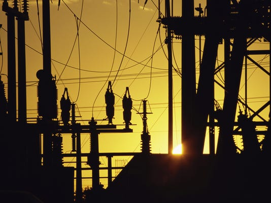 Silhouette of electric power pylons