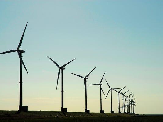 Silhouette of wind turbines on a landscape