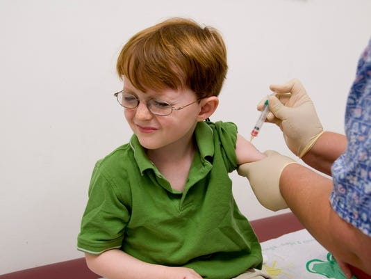 Child Receiving Injection Vaccination with Syringe from Nurse & Pain