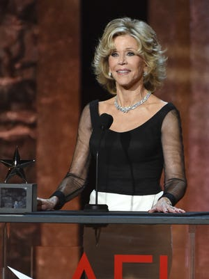Jane Fonda accepts the AFI Lifetime Achievement Award at the 42nd AFI Lifetime Achievement Award Tribute Gala at the Dolby Theatre on Thursday, June 5, 2014, in Los Angeles. (Photo by John ShearerInvision/AP)