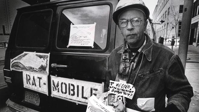 """Roy E. Fries, who had an issue with unenforced codes -- which he believe led to litter and then rats -- drove around the city in his """"Ratmobile,"""" a van adorned with pictures of rats."""