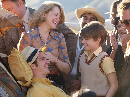 "A mishap becomes a party in ""Breathe"" for (from left) Robin (Andrew Garfield), Diana (Claire Foy), Jonathan (Henry Marcus) and David (Tom Hollander)."