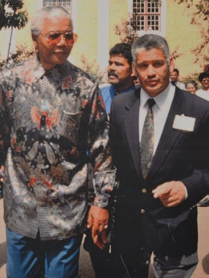 Nelson Mandela visited the small South African town of Genadendal in October 1995, and is seen here with curator of the Genadendal Mission Museum, Isaac Balie.