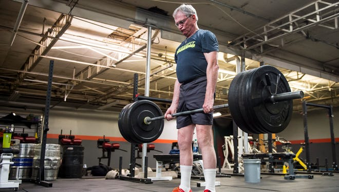 George Hubbard, 74, deadlifts 265 pounds during a workout session at Adams-York Performance Center in McSherrystown.  Hubbard, who began CrossFit training four years ago, underwent double knee replacement surgery in 2016, but was back working out six weeks later.