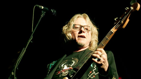 Mike Mills of the group R.E.M. performs at Madison