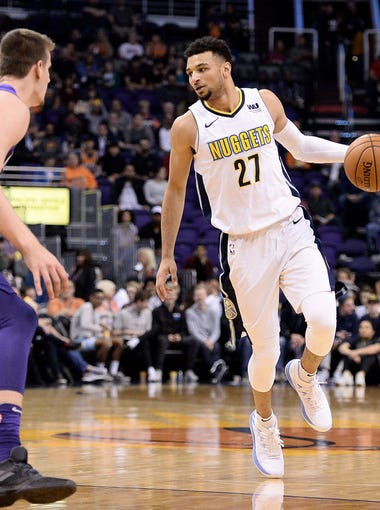 Feb 10, 2018; Phoenix, AZ, USA; Denver Nuggets guard Jamal Murray (27) handles the ball in front of Phoenix Suns forward Dragan Bender (35) in the first half at Talking Stick Resort Arena. Mandatory Credit: Jennifer Stewart-USA TODAY Sports