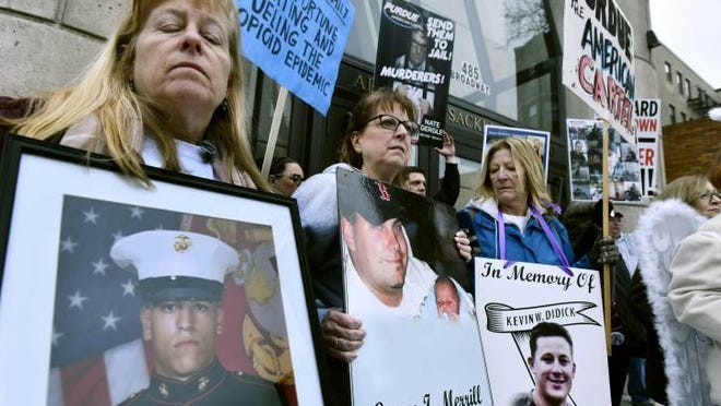 Cheryl Juaire, second from left, of Marlborough, participates in a protest last year in front of the Arthur M. Sackler Museum at Harvard University in Cambridge. Juaire, whose son Corey Merrill died of an overdose in 2011, led a demonstration by parents who have lost a child to opioid abuse, campaigning for the removal of the Sackler family name from the building at Harvard.