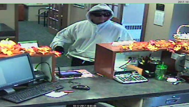 The suspect in a robbery at the Hershey Federal Credit Union in Annville.  The suspect, who police say could be either male or female, didn't display a weapon, but fled on foot with with an undetermined amount of cash and may have left the area in a dark blue or black SUV, police said.  No one was hurt in the incident, according to police.  Annville Township police ask anyone with information regarding this incident to call them at717-867-2711.