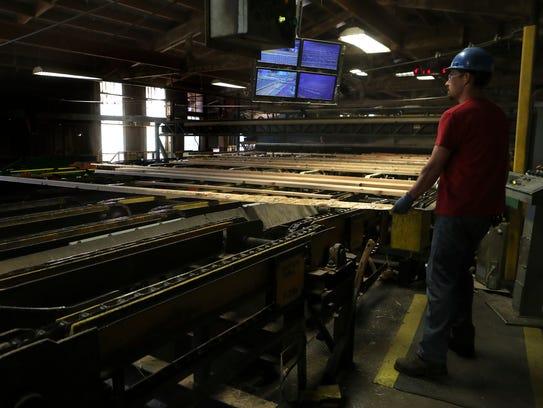 Sierra Pacific Industries employee David Pflueger watches