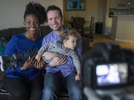 Gabrielle Flowers Rader, with husband Chad Rader Sr., and Chad Rader Jr., 21 months, who produce the Babe and Gabe Youtube show, at their apartment in Fishers, Thursday, Nov. 6, 2014.