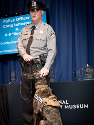 """Craig Johnson, an officer with the Cumberland County Sheriff's Office, and his late K-9 partner Boomer, were honored for """"Individual Community Service"""" at the 11th annual Awards of Valor Ceremony at the National Liberty Museum in Philadelphia. Officer Johnson and his current K-9 partner, Cita, are pictured at the awards ceremony on Oct. 6."""