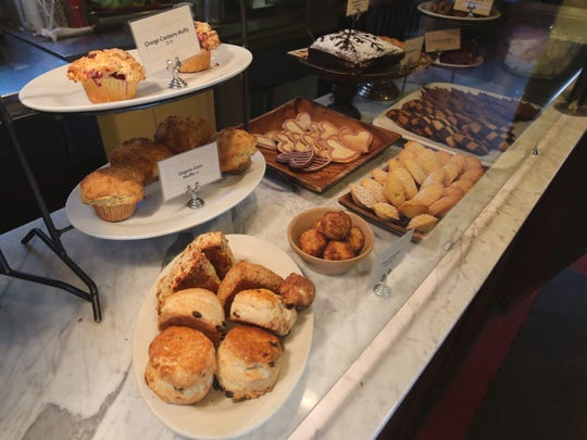 The front counter filled with scones, muffins, cakes and more at The Village Tearoom Restaurant and Bake Shop in New Paltz.