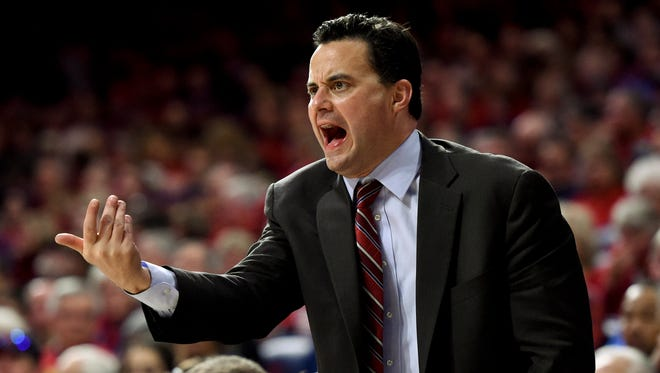 Arizona Wildcats head coach Sean Miller signals to his players during the second half against the Washington Huskies at McKale Center. Arizona won 99-67.