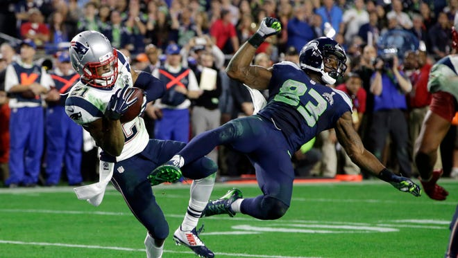 FILE - In this Feb. 1, 2015, file photo, New England Patriots cornerback Malcolm Butler (21) intercepts a pass intended for Seattle Seahawks wide receiver Ricardo Lockette (83) during the second half of NFL football's Super Bowl XLIX in Glendale, Ariz. New England won 28-24. (AP Photo/Kathy Willens, File)