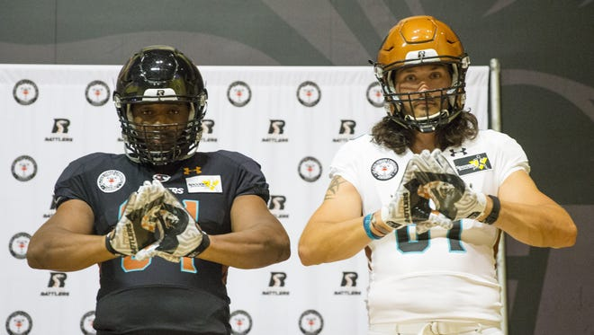 Arizona Rattlers MLB Tyre Glasper (left) and WR Chase Deadder model the new home and away uniforms respectively during media day at Talking Stick Resort Arena March 29, 2016.