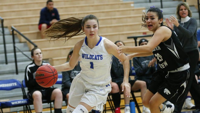 Mesquite guard Shaylee Gonzales (1) dribbles past Marana Mountain View guard Zaryna Urbina (20) during the first round of the 5a state conference tournament in Gilbert February 14, 2017. Mesquite won 93-31.