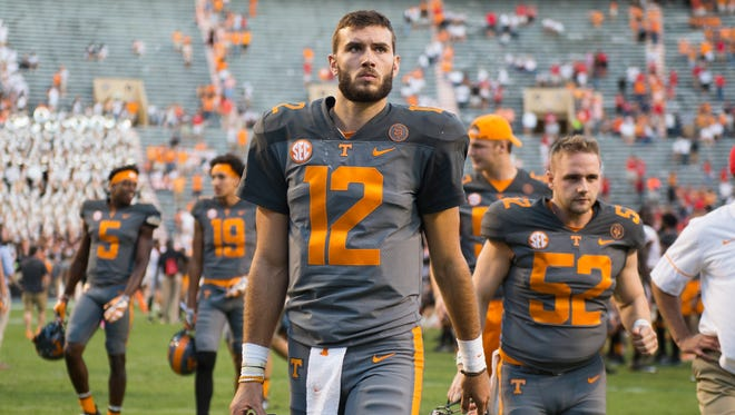 Vols quarterback Quinten Dormady (12) walks off the field to the locker room after Tennessee's 41-0 loss to Georgia at Neyland Stadium on Saturday, Sept. 30, 2017.