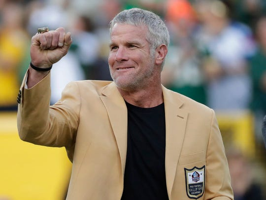 Brett Favre shows off his Pro Football Hall of Fame