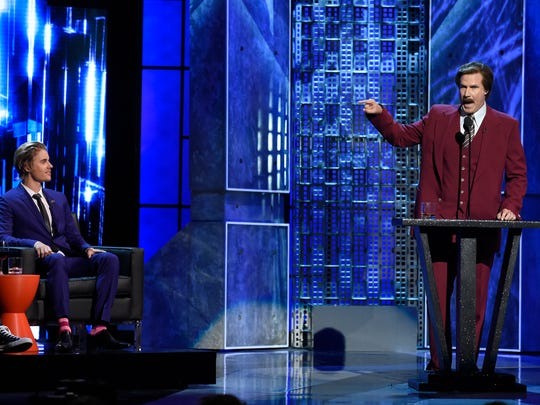Will Ferrell (R) appears in character as Ron Burgundy