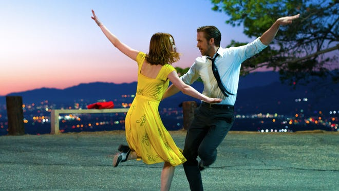 Emma Stone and Ryan Gosling dance in this scene from the musical 'La La Land.'