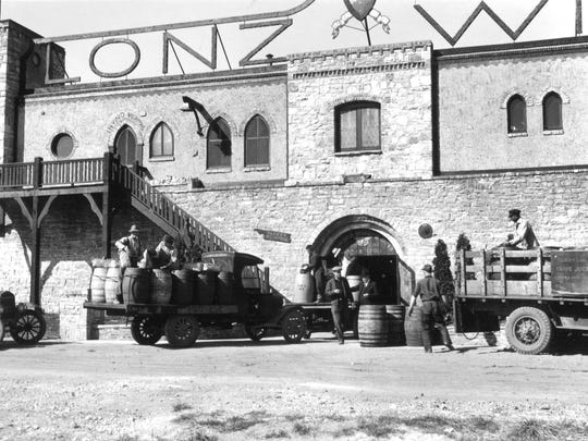 Lonz Winery workers load casks of the world-famous grape juice — because of Prohibition — onto a truck in the 1920s. The Bavarian-styled building behind them burned down in 1942 and was rebuilt into the structure still present on Middle Bass Island.