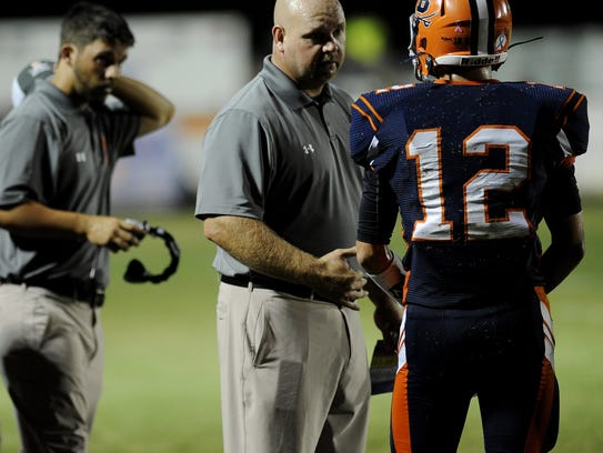 Beech High School coach Anthony Crabtree talks with